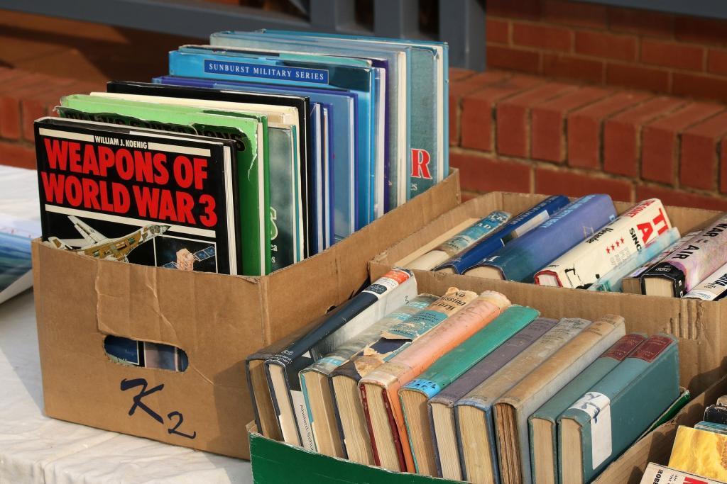 packing books into cardboard boxes for moving