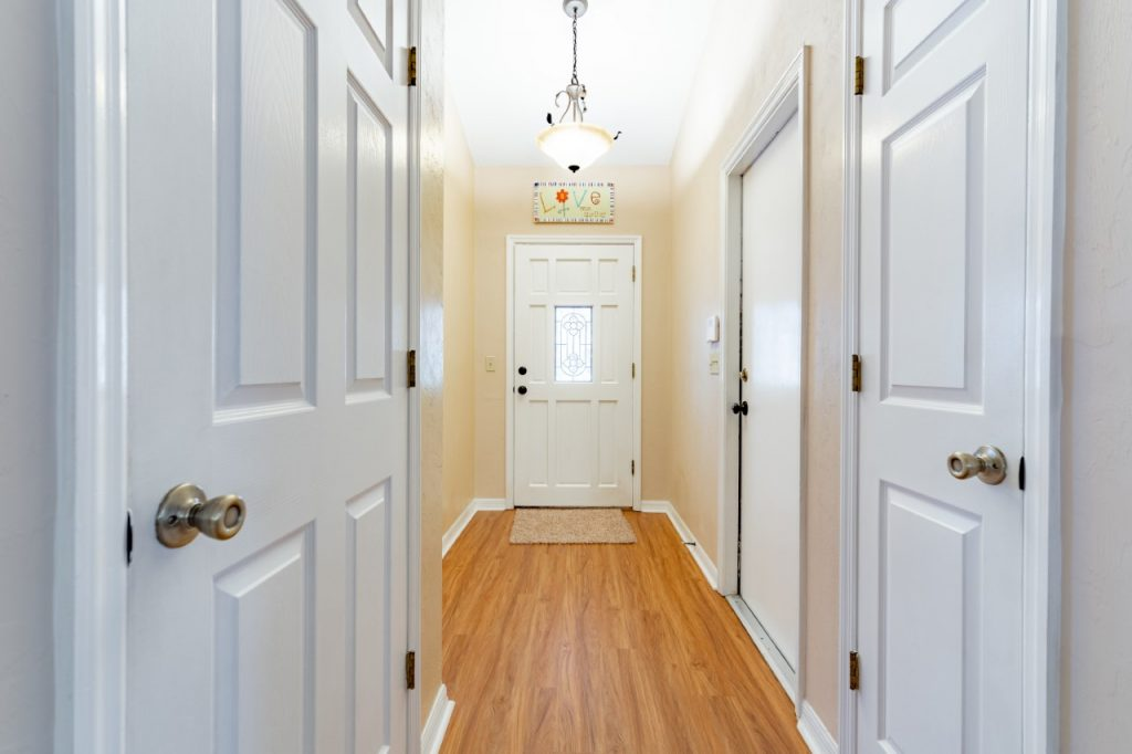 Increase the wattage in all light bulbs, especially hallways; consider removing all screens
